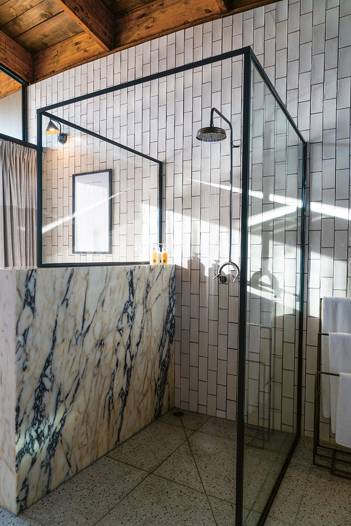 Marble on the shower partition adds texture and interest.