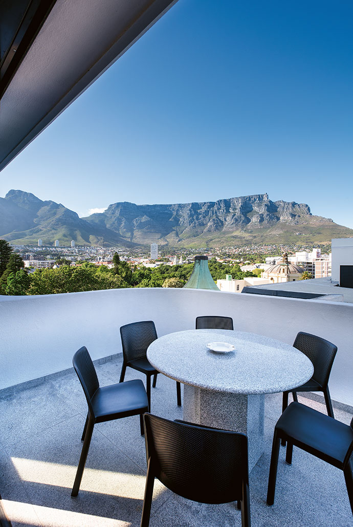 The Keerom Street Chambers' green copper turret is a pleasant interruption to a panoramic view of Table Mountain. The granite table is by Sangengalo Marble & Granite and is surrounded by chairs from Chair Crazy.