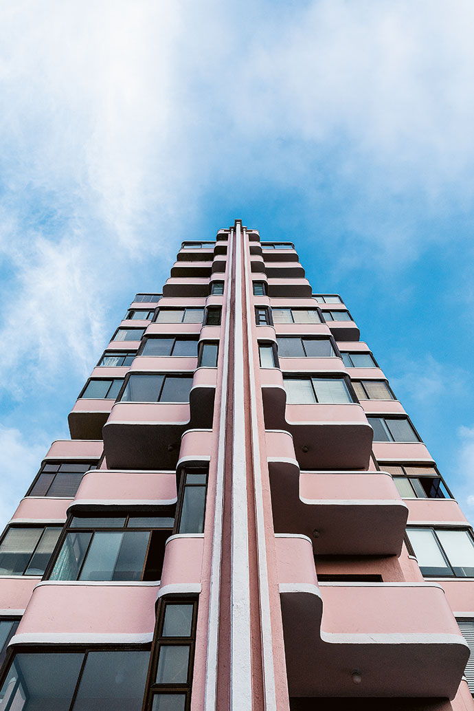 Holyrood's distinctive pink exterior paint and curvaceous Art Deco facade make the building instantly recognisable.