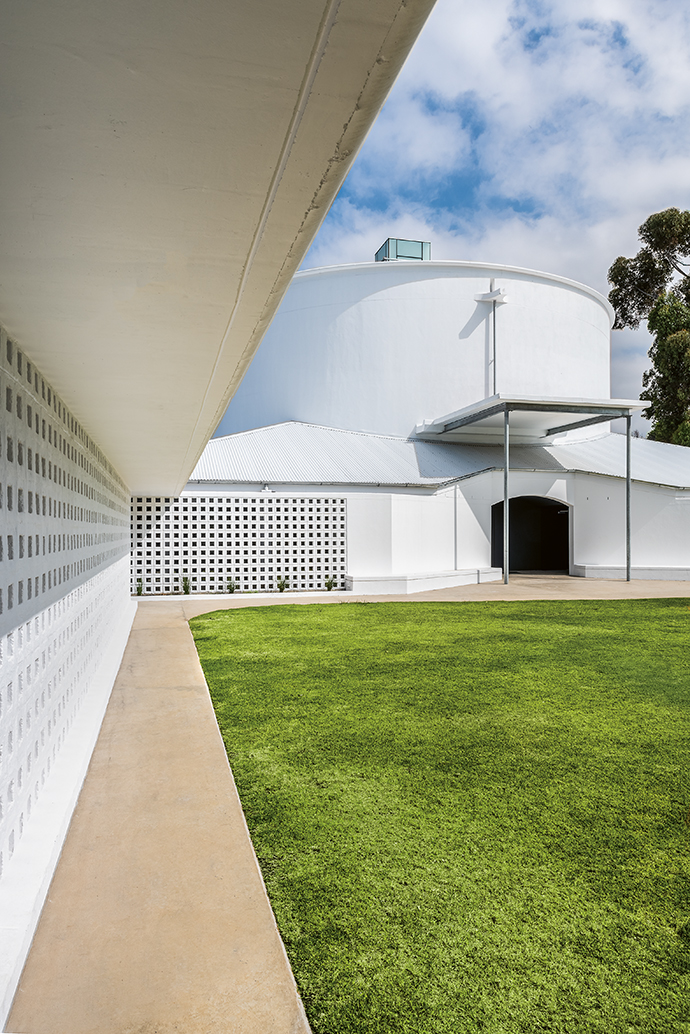 A grassed courtyard links the old church building – now converted into a hall and performance space – and the new one, built around 25 metres away.