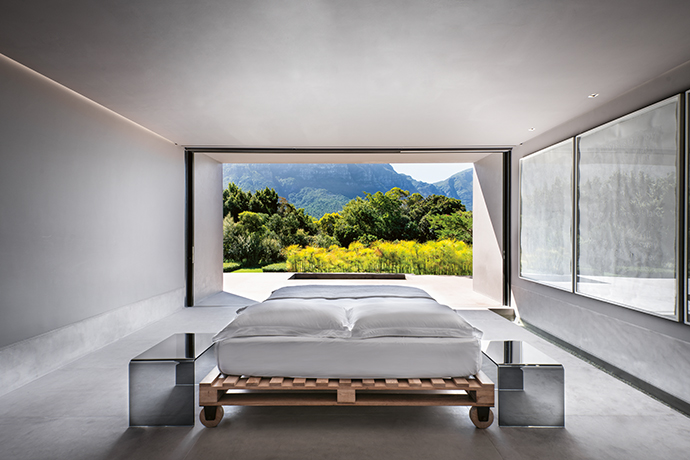 A minimalist's dream: everything in this bedroom is cleverly concealed to not detract from the perfectly framed view.