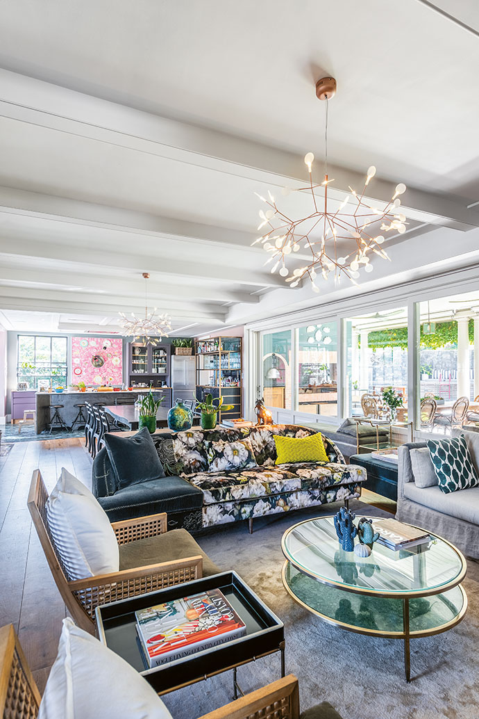 The airy open-plan space that incorporates the lounge, dining room and kitchen has a quirky, colourful cosiness, thanks to Paula's deft interior design hand.
