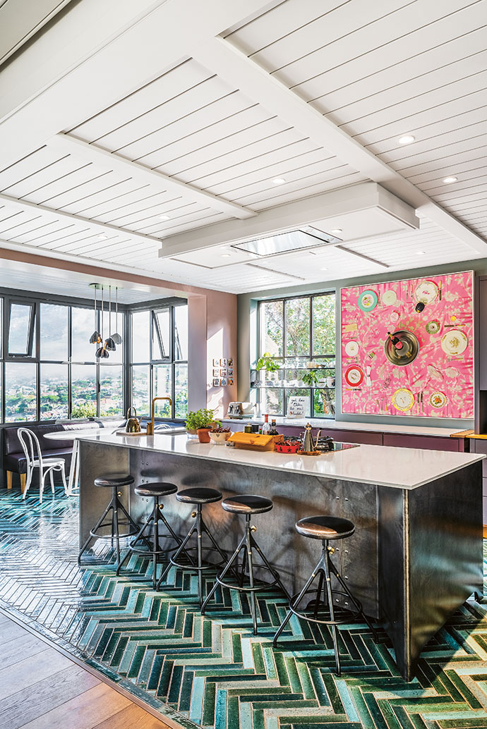 A steel island, designed by architect Wynand Wilsenach, and one of Caryn Scrimgeour's still lifes set the tone for the decidedly un-kitcheny kitchen.