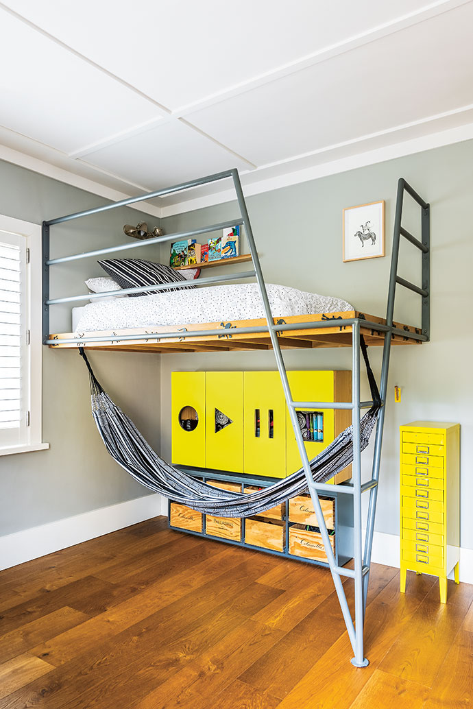 The platform bed in Christo's room was made by Liesel Rossouw and her husband Sias, and the yellow cupboard below was made in collaboration with Paula.