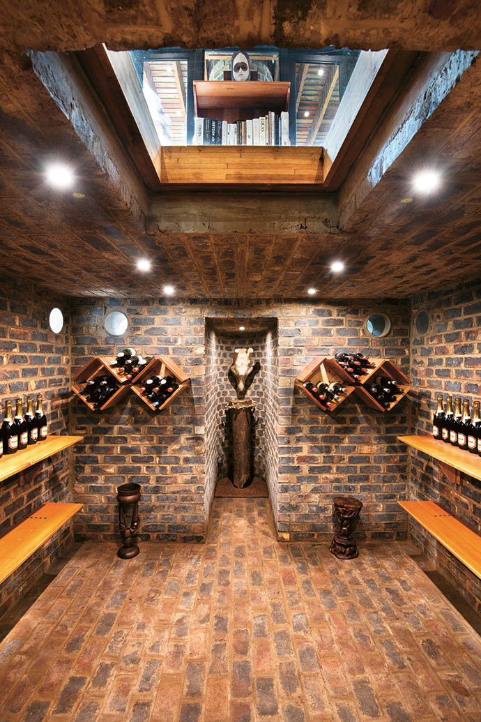 The subterranean cellar is ventilated by a cooling chimney that begins here and rises up through the office and kitchen above.