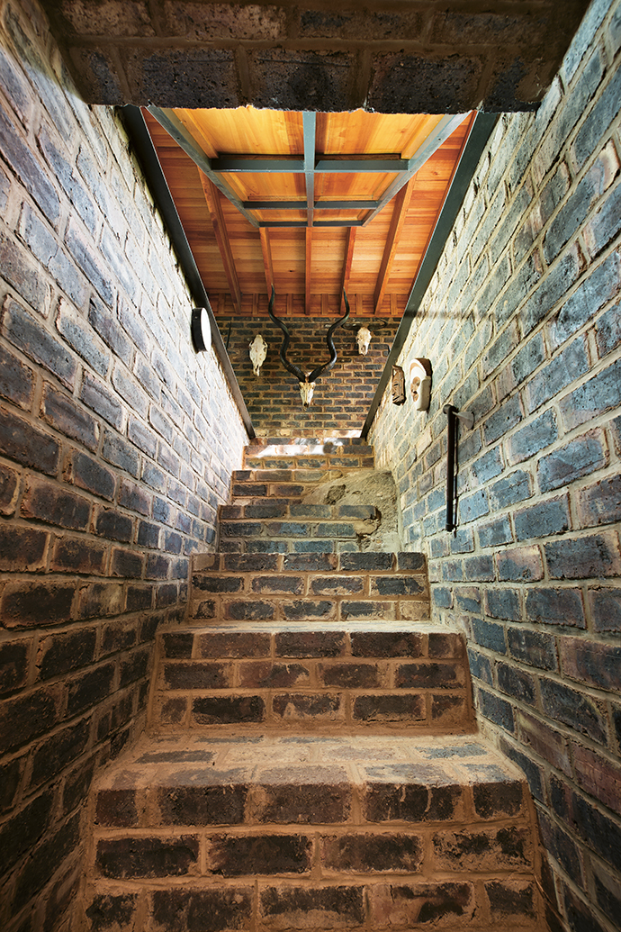 The interior staircase was redesigned during construction to save two trees.