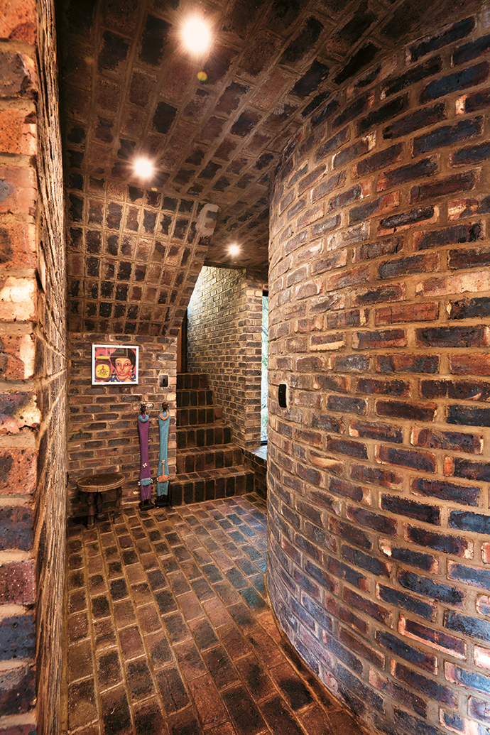 The wall en route to the downstairs office is curved to accommodate a combretum tree.