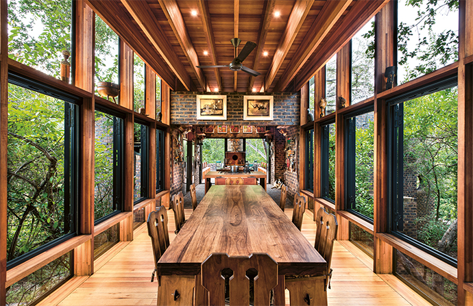 Bringing a natural warmth to the interior, much of the wood is saligna, which is both affordable and sustainable. The large dining table was commissioned by the homeowner's father, and is about 60 years old.