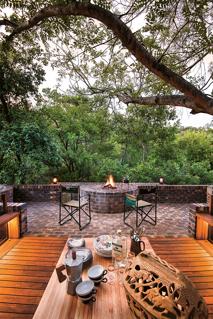 Under open skies and in the company of trees, is where the homeowners do most of their cooking.