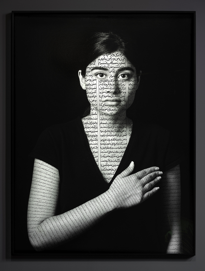 Installation view including Shirin Neshat, Nida (Patriots), from The Book of Kings series (2012)