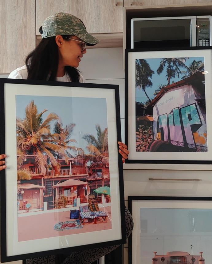 Celeste with her framed prints.