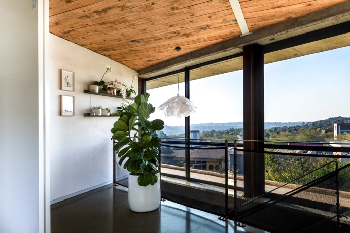 The first floor landing invites views over Pretoria. The ceilings are reclaimed pine shutter boards.