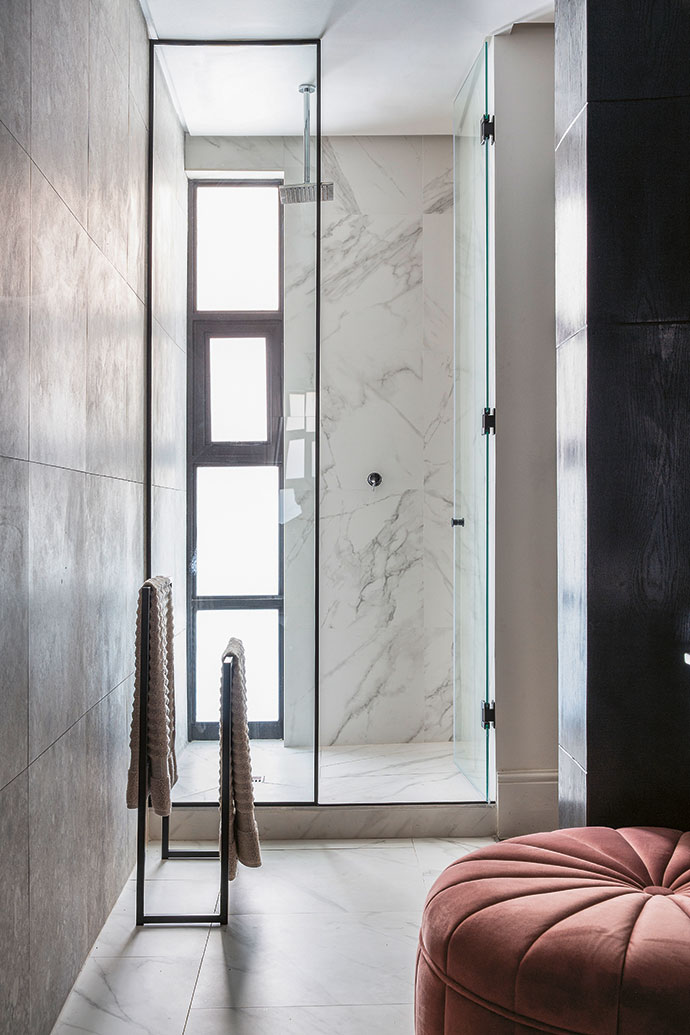 The apartment's bathroom is clad in porcelain stoneware tiles from Mirage.