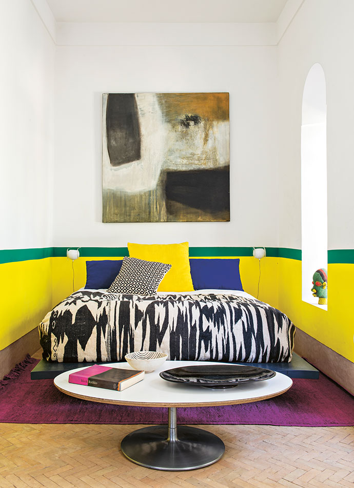 On the ground floor, guest rooms are finished in cheerful colours.