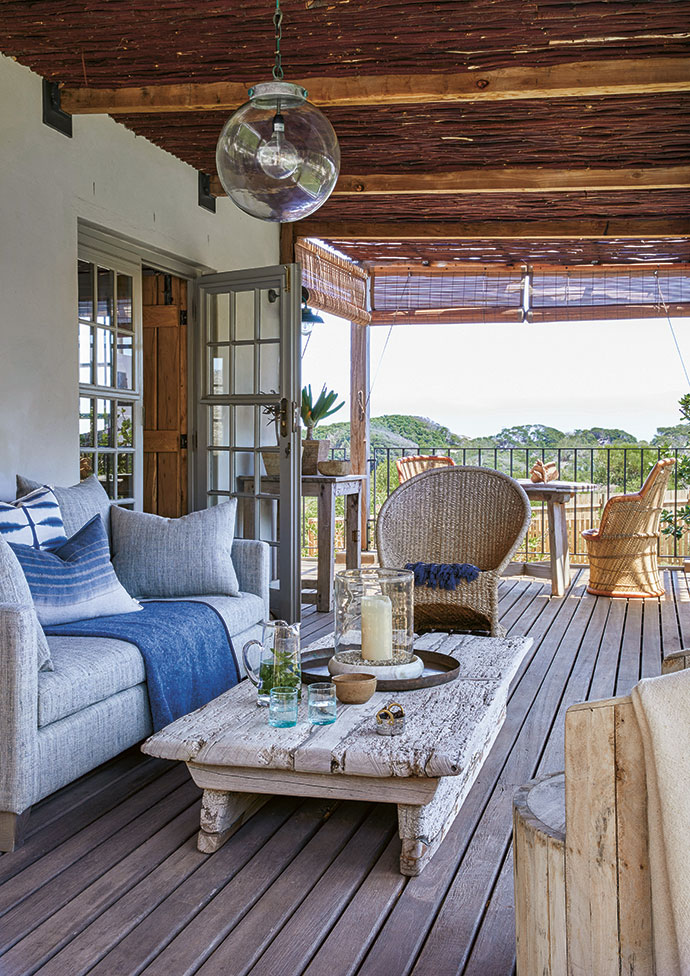 The upstairs veranda features the Naga tribe coffee table and a Cécile & Boyd tub chair.