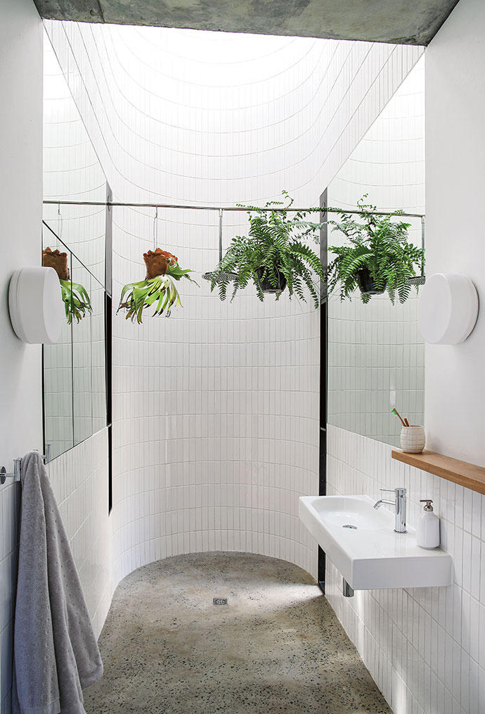 The statuesque ceiling height transforms the shower area, which was custom-made by Still Bathrooms, into an extraordinary space.Standard 200x200 white tiles were cut into quarters here, creating textural variation.