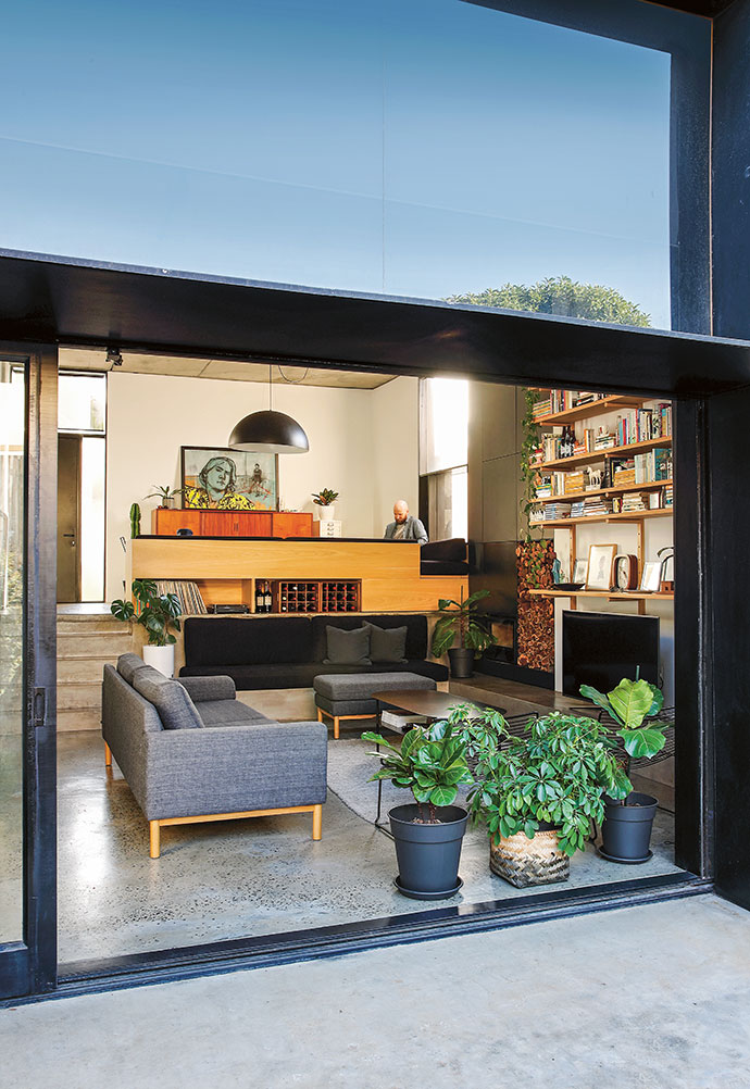 Opening up the sliding doors makes the courtyard part of the living area.