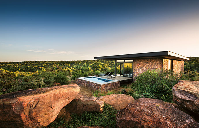 Recast in perfect built form, the natural stone structure echoes the scattered boulders that surround it.