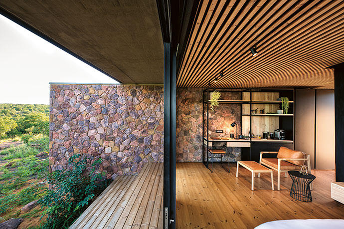 Natural wood and stone interior finishes take their cue from the exterior palette, melting away the boundaries between inside and outside.