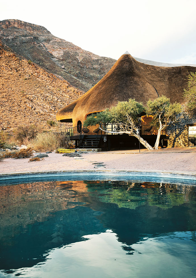 The double-volume thatched domes overlook the pool.