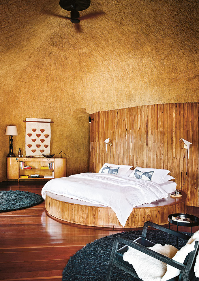 The main bedroom features a circular king-sized bed custom made on site by local artisans with interior designer Maybe Corpaci.