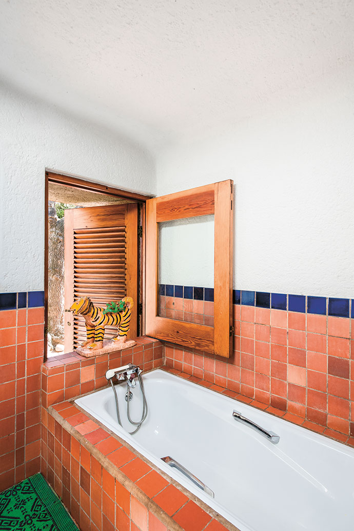 Everywhere, even in the bathroom, the interiors connect with courtyards and outside spaces. In the window is an Ardmore