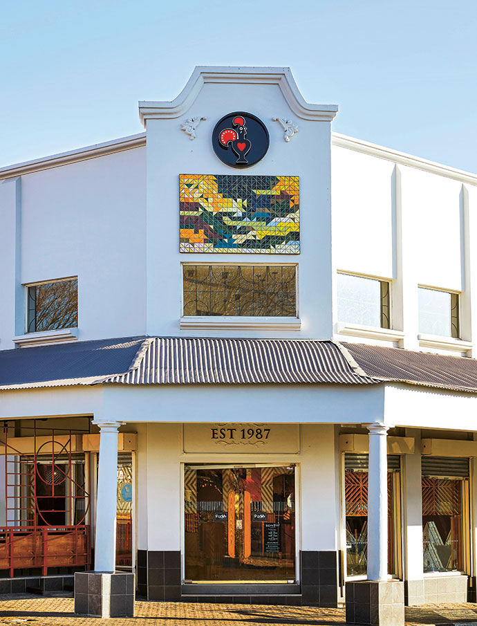 The exterior is now adorned with a Half Square tiled art piece by Jenny Parsons supplied by Spier Arts Trust.