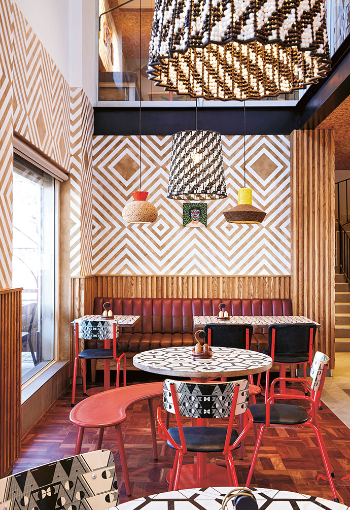 Black and white beaded lights by Mash.T combine with Wiid Design's cork pendants. The Naturalis chairs sport a pattern by Nando's Hot Young Designer Talent Search finalist Sapamandla Mdunyelwa.