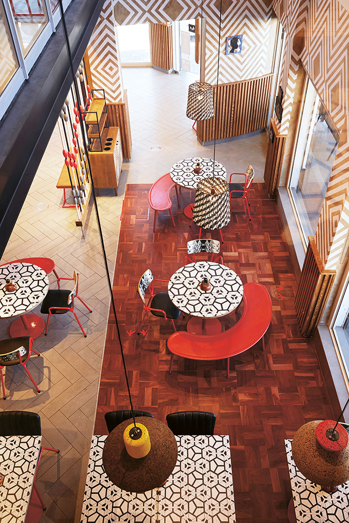 The red benches are from Houtlander and the tables feature a pattern by Nando's Hot Young Designer Talent Search finalist Primrose Chimhanda.