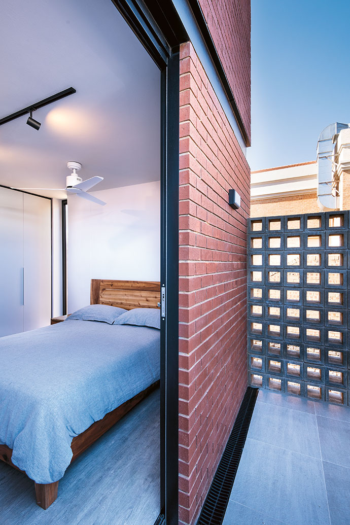 The brise-soleil with air bricks from Old World Concretes subtly shields residents from neighbouring developments.