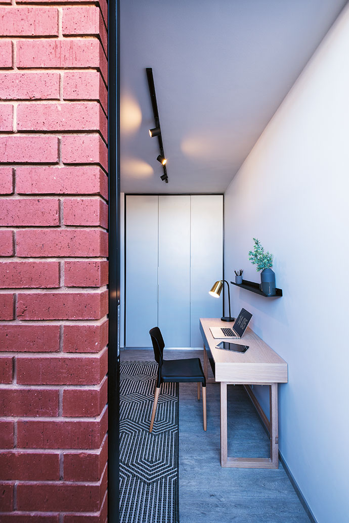 The 11-square-metre third bedroom acts as an office or study; the desk is from Trestle South Africa.