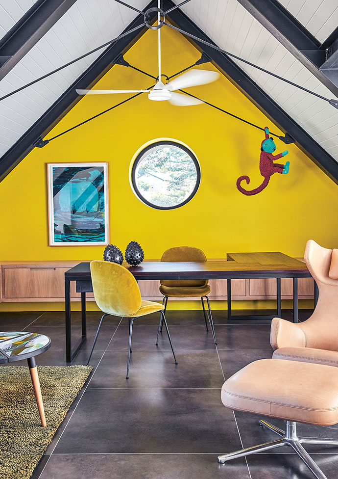 Jim's office is a den for creativity, its mustard-coloured wall stimulating the senses, while the circular window offers a unique frame of the verdant garden.