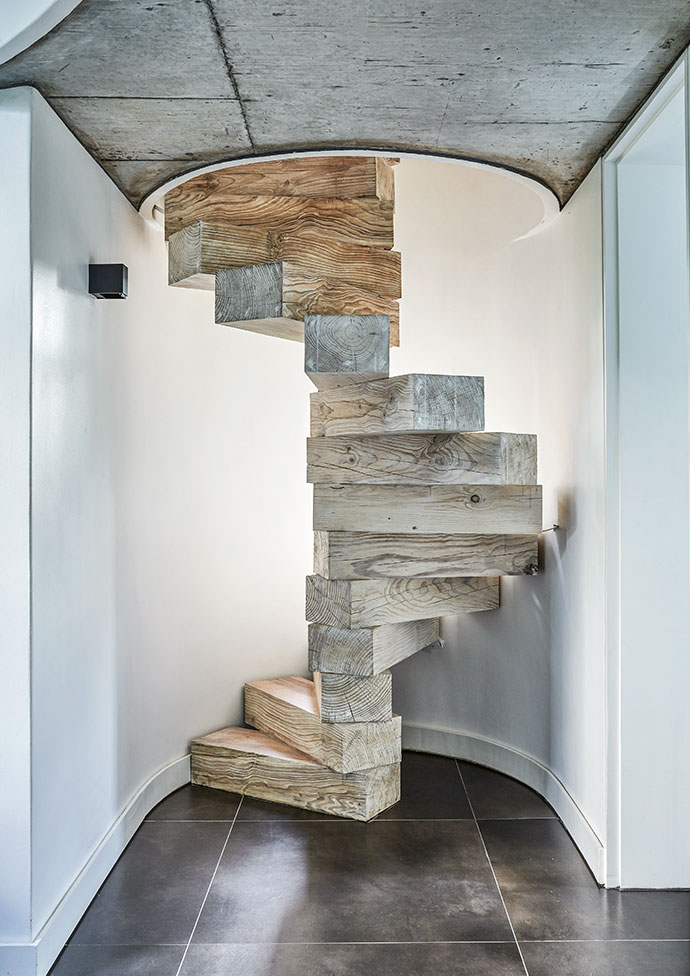 The floating spiral staircase leading up from the master bedroom to Ed's office was conceived and built by Hout Bay woodworker Sam Pellissier.