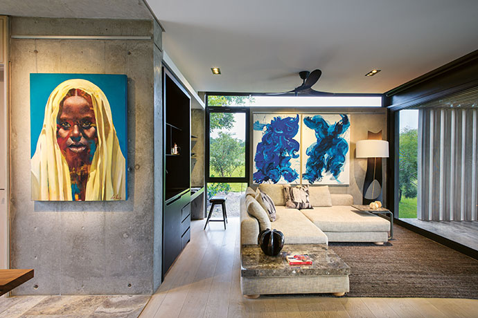One of the guest suites at Karula House, known as the Mccreedy Suite, features the artist's Blue Double Abstract as well as Loyiso Mkize's Veiled Lady.