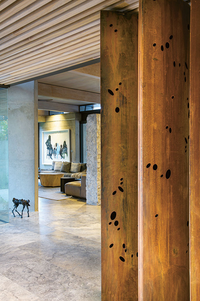 Overlooked by Azael Langa's After The Rush Hour, the formal lounge at Mvula House also features a wild dog sculpture by Gail Catlin at the entrance.