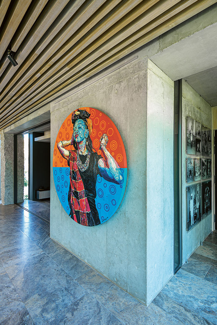 Sibongile by Sanusi Olatunji injects a spark of colour to the open-plan main living area of Karula House, which is also decorated with a commissioned assembly of framed photographs, displayed with permission from the artist, Gail Catlin.