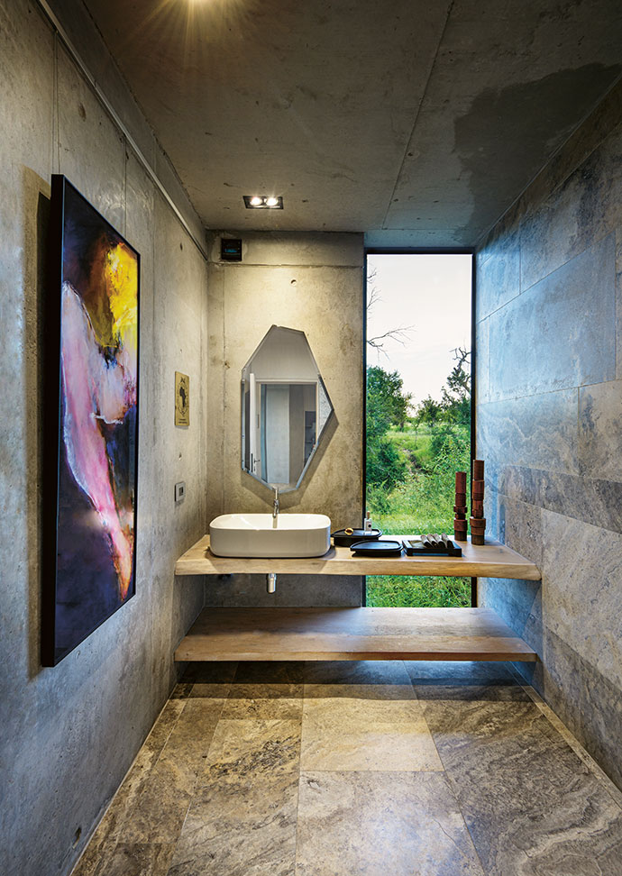 Even the guest bathrooms are filled with artworks – this one at Karula House is an untitled piece by Gail Catlin.