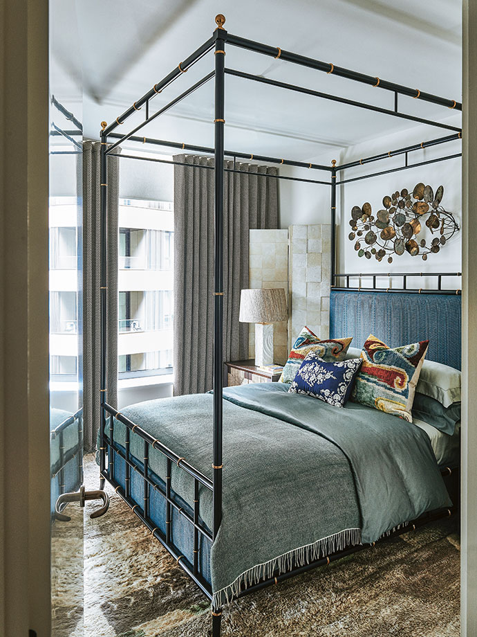 Hubert's bedroom reflects his love of fabric and colour. The four-poster bed is an HZI design, and the throw is from Coral Stephens in Eswatini. The vintage plaster table lamps were found in a Paris flea market.