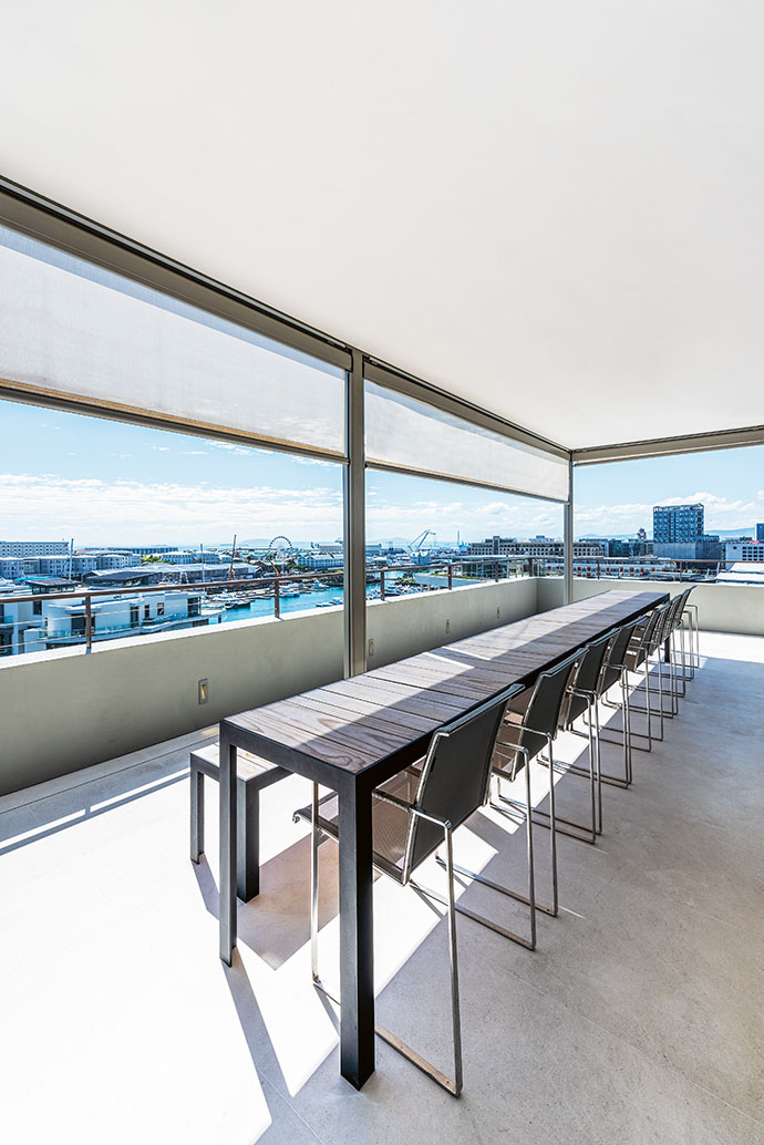 A dining set designed by Elzanne le Roux-Preis takes pride of place on the balcony.