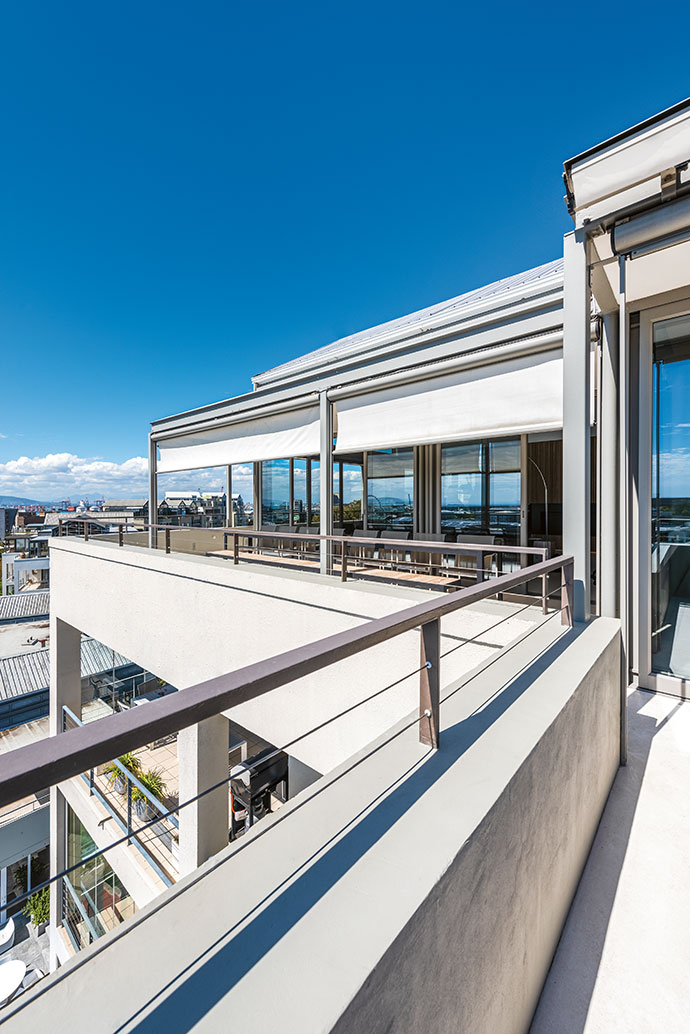 Panoramic views of the city and ocean can be taken in from the wraparound balcony.