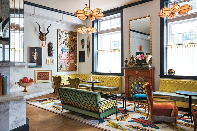 For Pamela, the challenge was to make the once formal room feel like a corner of a collector-traveller's grand home. Floor-to-ceiling art – mostly Egyptian, Indian and African collectibles, along with rebirth iconography such as snakes and eggs – draws the eye upwards and enhances the residential feel.