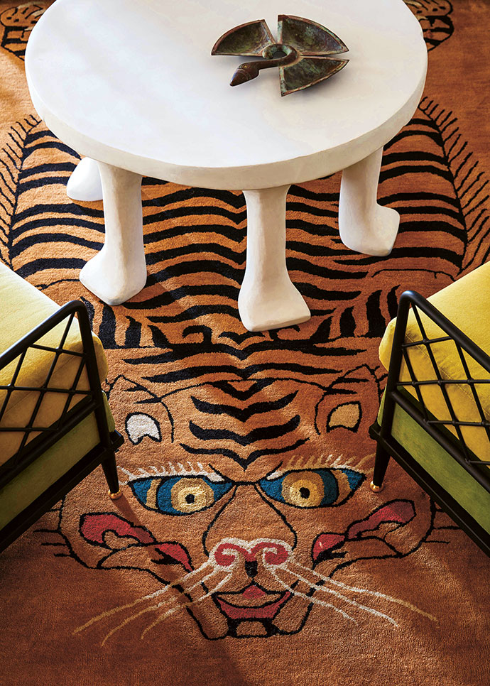 Pamela collaborated with Christopher Farr on the design of the guest lounge's menacing tiger carpet.