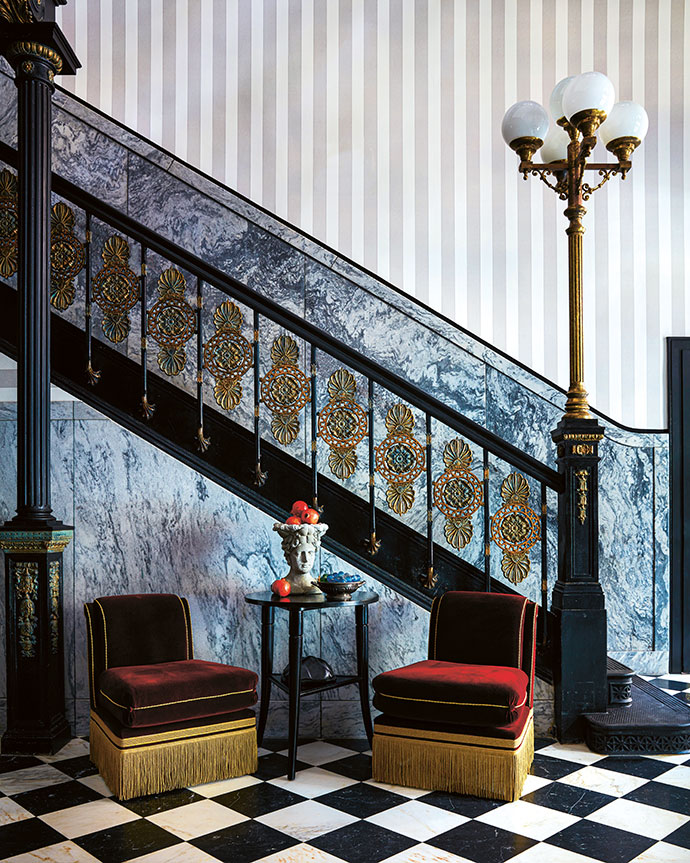 """The statement-making lobby sets the tone for the guest experience. """"It's a nod to traditional hotel luxury, but there's the Ace twist to it – it's very thoughtful,"""" says designer Pamela Shamshiri of the consideration that went into the space. The chequered marble floors were restored, and a dusting of gold added to the detailing of the original twin staircases to enhance their French flair. Sourced from local antique stores, nautical collectibles are reminders of the Mississippi beyond."""