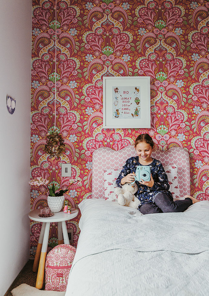 Bo's bedroom features wallpaper by Eijffinger and a headboard upholstered in fabric by Design Team. The bedside table is from IKEA.