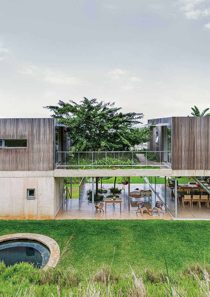 """The front of the house is clad in hard-wearing raw balau timber, which is ageing naturally. Karl Wang of KR Projects, the contractor who built the house, was """"exceptional"""", says Lisa, dealing with all challenges effectively and expediently."""