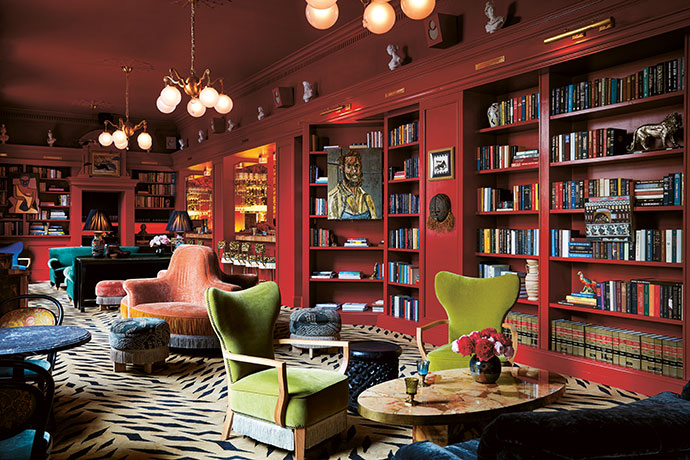 Scarlet-coloured bookshelves add a flirtatious element to Bar Marilou, the only space in the hotel that is open to the public rather than reserved for use by its guests. Designed with the guidance of French hospitality consultants Quixotic Projects, the bar's fringed seating adds naughtiness to the night-time boudoir mood.
