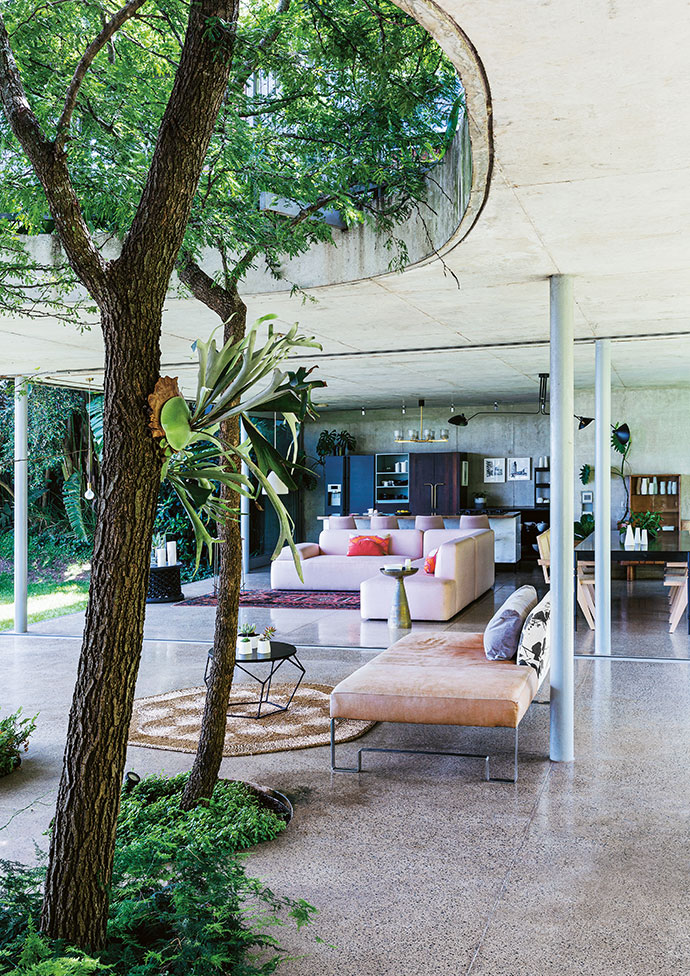 The open-plan ground-floor living spaces link to the garden via glass doors on both sides, helping to keep the house cool during Salt Rock's humid summers. The day bed with metal legs is one of Lisa's own designs.