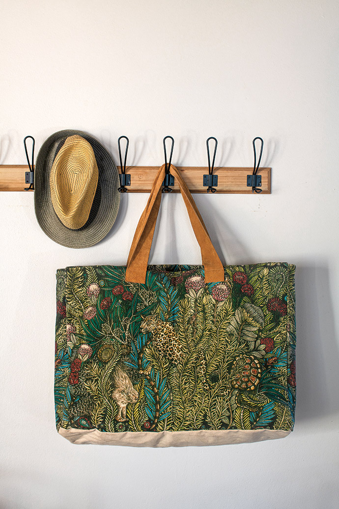 A one-of-a-kind Bomba bag, ideal for trips to the river, is based on a Katie Lund wallpaper design.