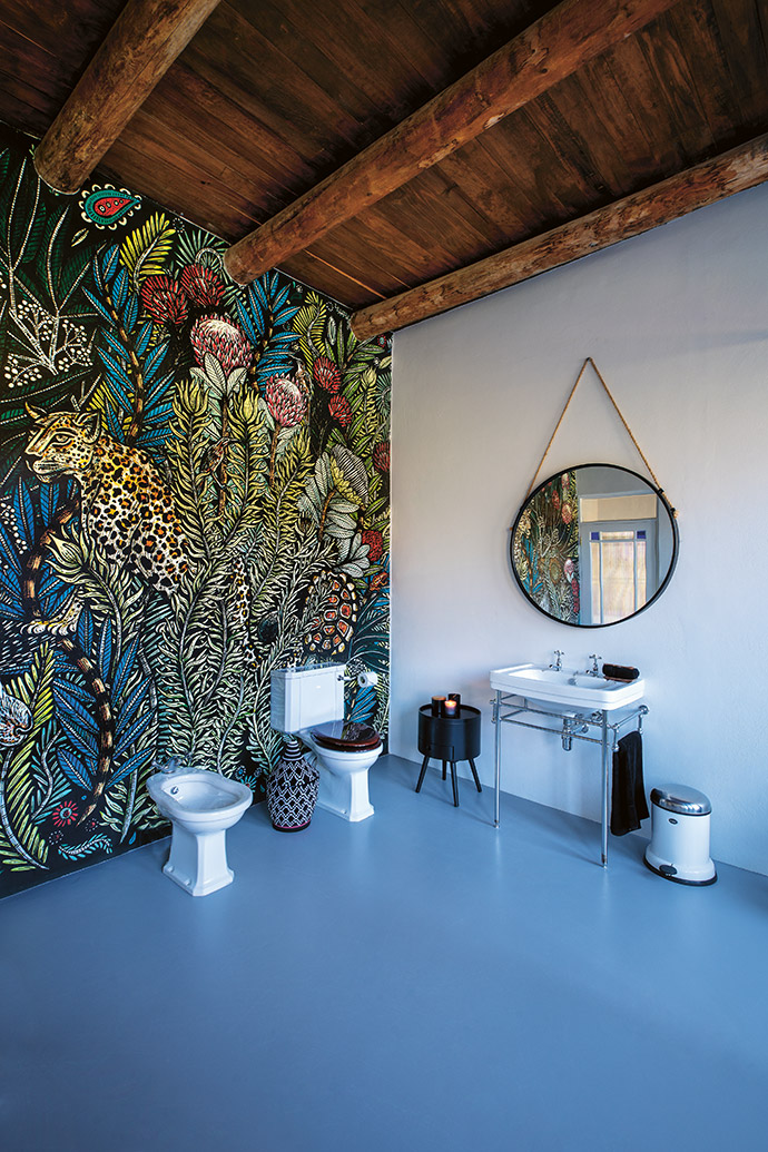The guest bathrooms got a dramatic makeover with bespoke wallpaper by Katie Lund.