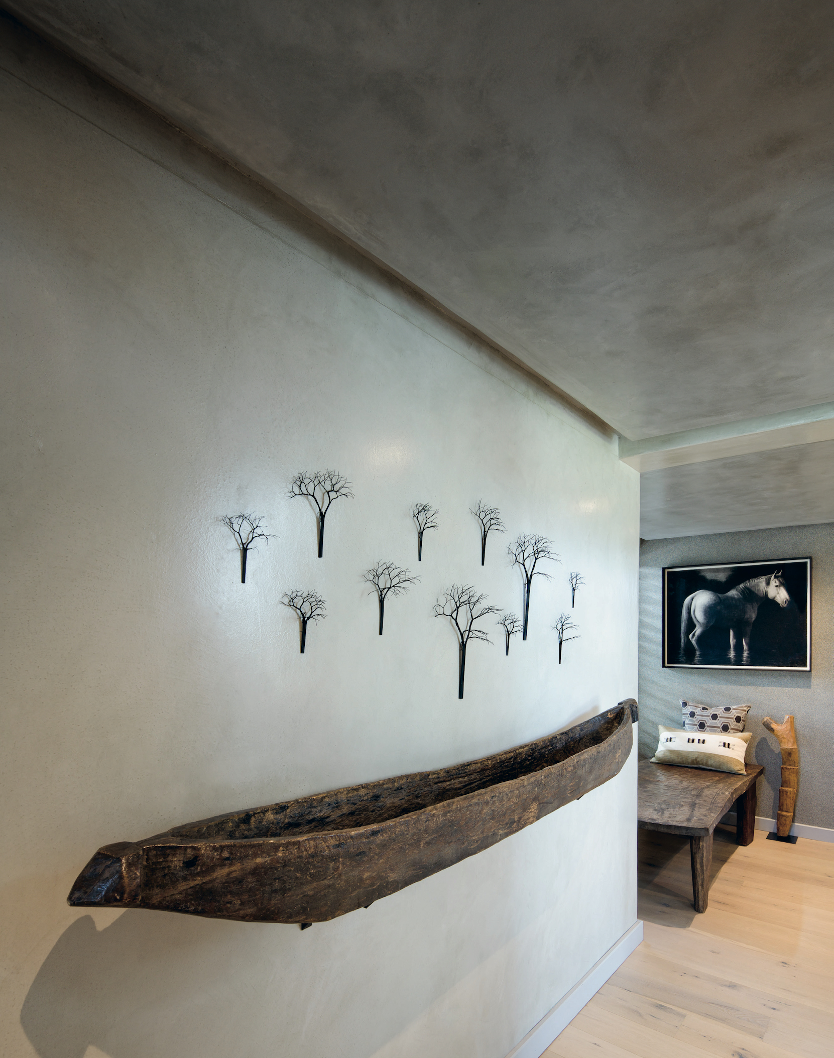 A traditional mokoro canoe from the Okavango region is mounted on the wall as a work of art.